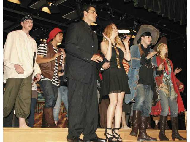 Members of the Regional Occupational Program's entertainment class served as emcees and entertained guests with a pirate-themed production number.