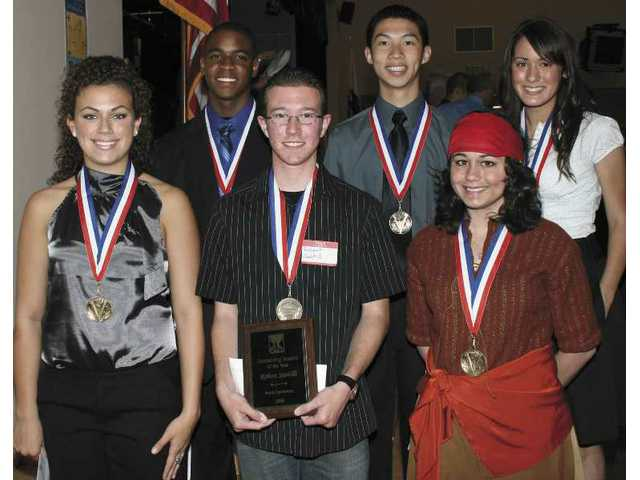 Robert Santilli, center, has been named Regional Occupational Program Student of the Year. With him are gold medalists, clockwise from left, Adriana Farrell, Darren Young, Kevin Chang, Katie Jurado and Carinne Urrutia.