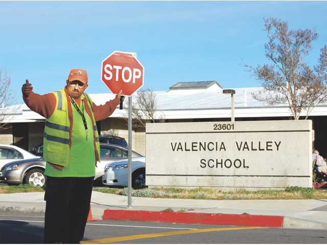 Francis Scaramella, 62, is a city crossing guard near Valencia Valley School.