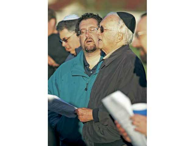 Mitch Allen (left), of Stevenson Ranch, and his father Art Allen join in a prayer during Temple Beth Ami's sunrise blessing Wednesday at Richard Rioux Park in Stevenson Ranch.