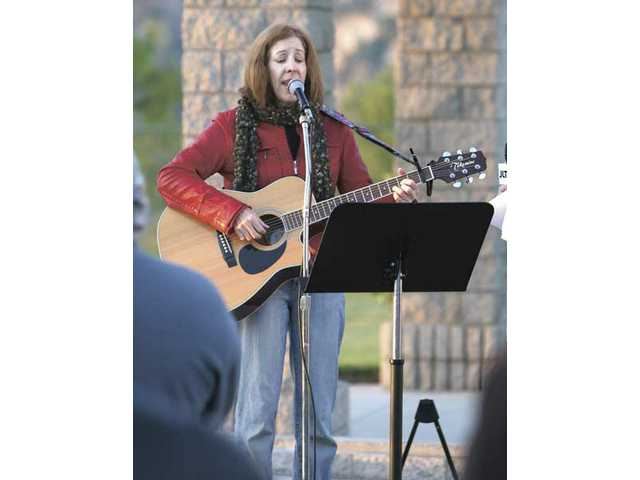 Wendy Hersh of Castaic led the congregation of Temple Beth Ami in singing several songs during the local synagogue's service to mark the once-every-28-year blessing of the sun.