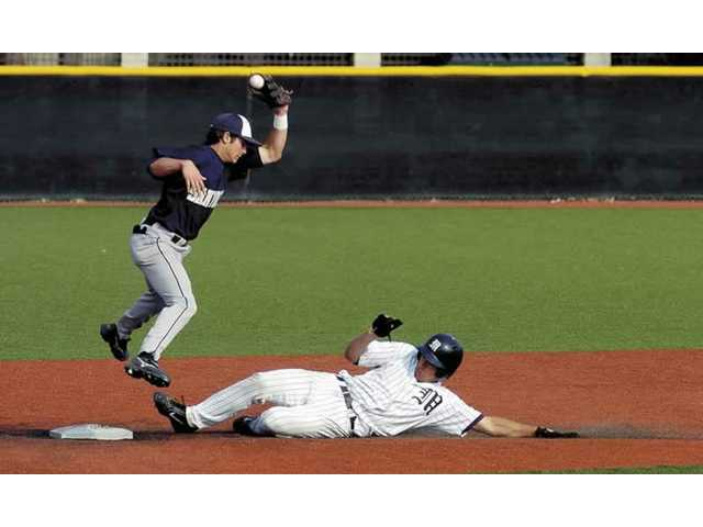 The Master's College baseball player Tyler Diamond slides into second base for the steal in the second game of a doublehader. TMC defeated the Hawks of San Diego Christian College 10-3 in the first game and 4-3 in the second second game at home.