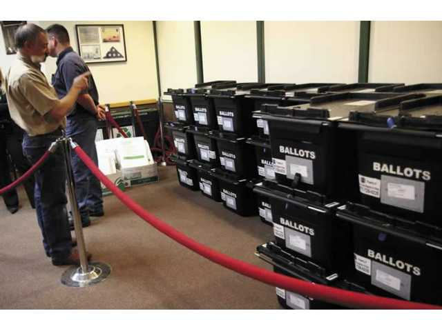 Boxes containing cast ballots were brought to City Hall on Tuesday night. Every third ballots cast in the council election was an absentee ballots.