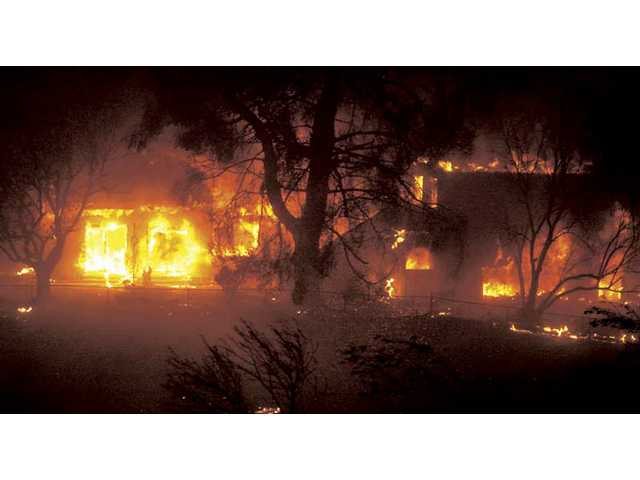 A building in Canyon Country engulfed in flames during the 2007 Buckweed fire. Carousel Ranch was recently given a $2.9 million bill for the damages done by the blaze.