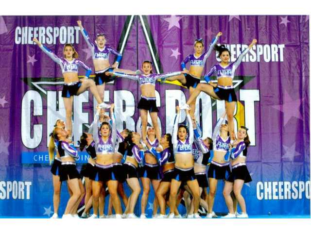 The California Flyers cheer team competes at the Cheersport Nationals in Atlanta.