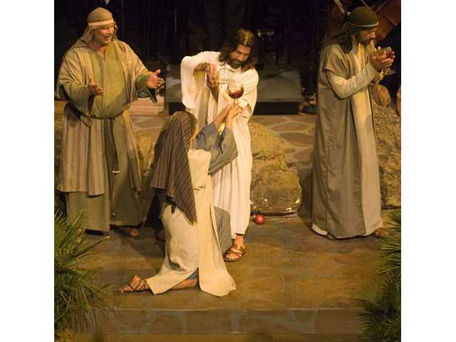 Rodger Halston, playing Jesus Christ, turns water into wine during the performance.