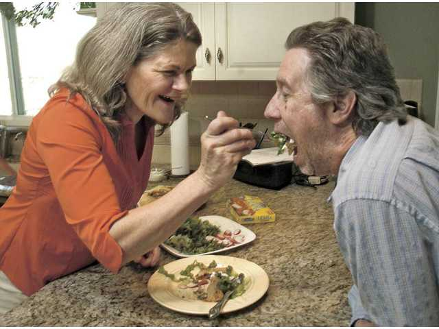 Merry Graham of Newhall feeds a bite of her Gorton's contest grilled chimichanga recipe to her husband Rick Graham. He is a willing taste tester for his wife's many original recipe creations. She is a finalist in the Gorton's Recipe Renovation contest.