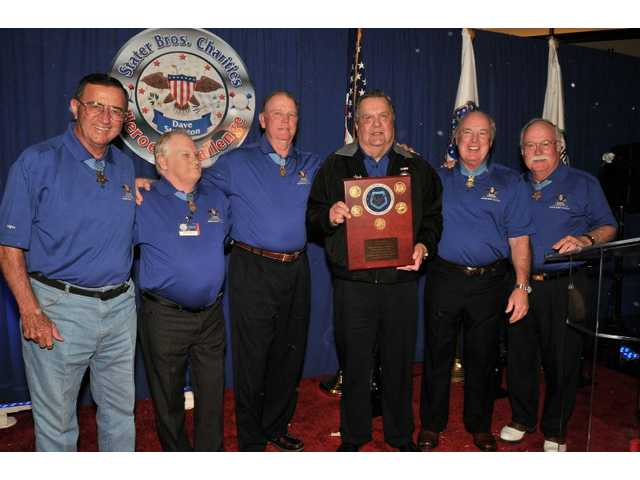 Five Medal of Honor recipients presented the award to Stater Bros. Chairman and CEO Jack H. Brown. Pictured left to right: Jay R. Vargas, John F. Baker Jr., Ronald E. Ray, Brown, James A. Taylor and Harvey C. Barnum.
