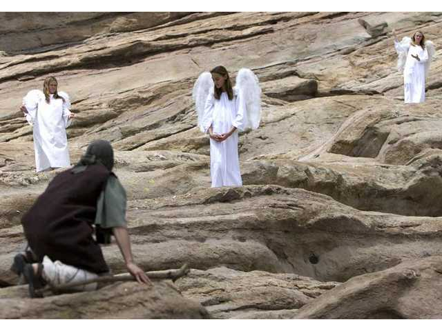 Actors of the Sunrise Service practice at Vasquez Rocks County Park before their matinee performance Saturday afternoon.