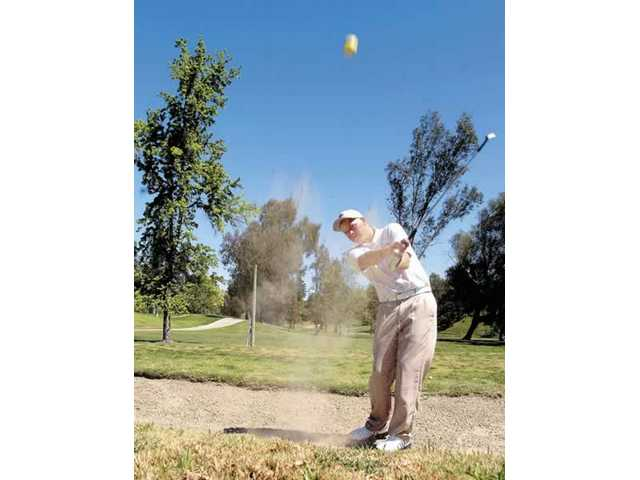 J.J. Holen blasts the ball out of the sand at a recent match at Vista Valencia Golf Course.