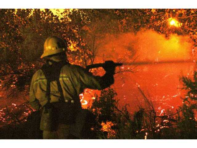Firefighters made quick work of a fire that scorched two acres in the wash near the intersection of Creekside Road and Town Center Drive Saturday night.