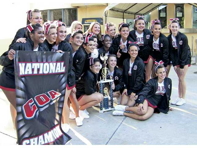 The Hart High School cheerleading team celebrates their first place finishes at a recent competition.