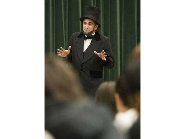 Actor Barry Cutler, dressed as the 16th President of the United States Abraham Lincoln, spoke to a group of students at La Mesa Junior High School Monday afternoon for the school's annual Abraham Lincoln assembly. Cutler spoke about the presidents' biography, and at the end opened it up for the kids to ask questions regarding the president.