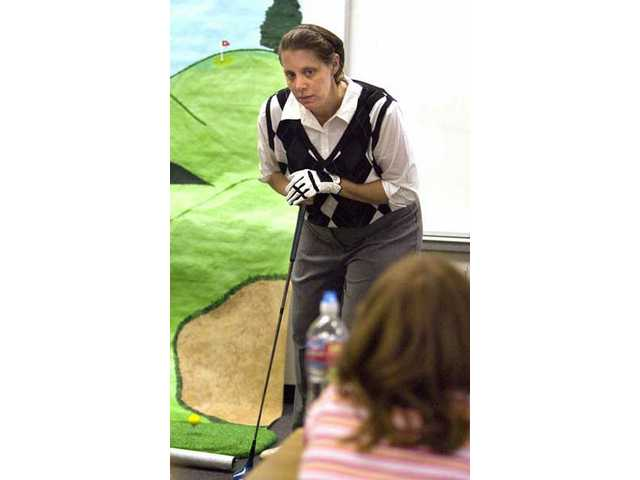 Portraying Babe Didrikson, Louise Willard, Careers Advisor at Saugus High School, dressed up in golf attire and spoke of Didrikson to a sixth-grade class at Rosedell Elementary School on Monday afternoon as part of the Women in History event.