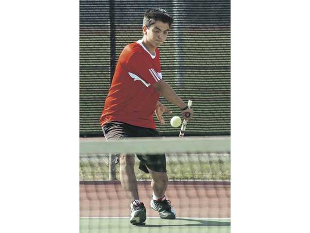 Joseph Reyes of Hart returns a shot against Canyon at Hart on Tuesday.