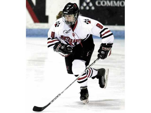 Alyssa Wohlfeiler, a graduate of Saugus High School, is now a star in a sport dominated by men -- ice hockey -- at Northeastern University.
