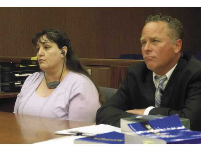 Esperanza Castro, left, and her attorney, Peter Korn, listen Monday as the prosecution presents its closing arguments in San Fernando Superior Court. Castro is accused of murdering her husband, Ramon Castro, and leaving his body in the back of his pickup truck parked under a freeway overpass in Canyon Country in 2006.