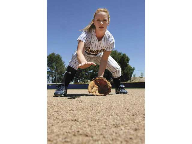College of the Canyons' second baseman Sarah Hasenfus was practicing her batting and fielding Monday. She was struck by a foul ball last year and suffered a serious head injury. She is working her way back to the team in '08.