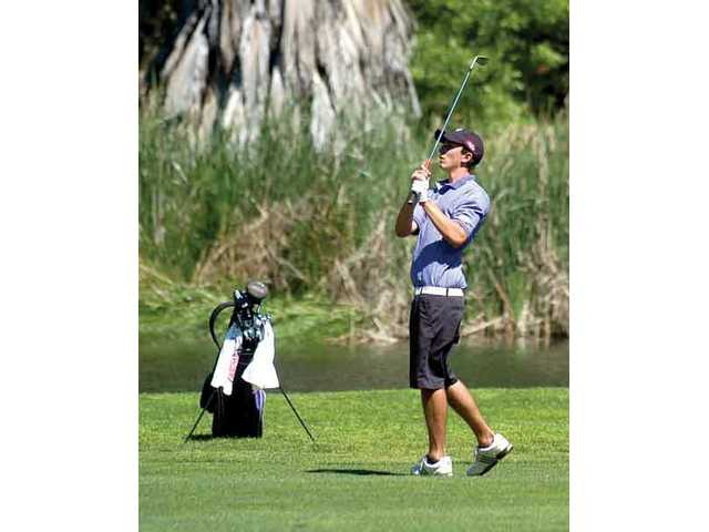 Max Homa from Valencia High plays golf on the eighth hole of the Valencia Country Club.