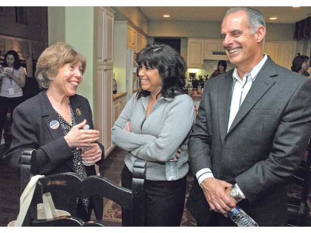 City Councilwoman Marsha McLean chats with supporters Dawn and Sam Langham at an election night party in Saugus on Tuesday.