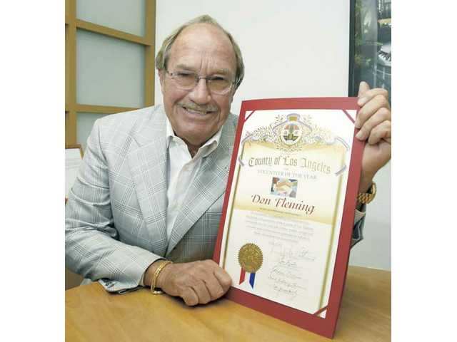 Don Fleming displays his Los Angeles County Volunteer of the Year Award. Fleming was nominated for the award by Supervisor Michael D. Antonovich's office.