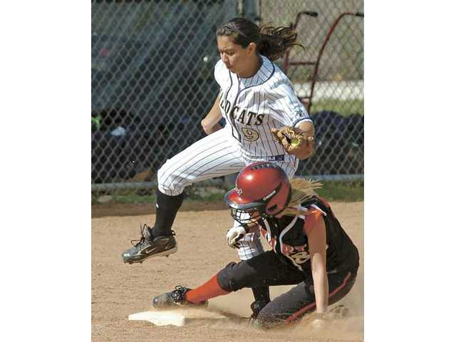 Hart's Allison Lewis, bottom, slides safely into third base under the throw to West Ranch's Breanna Santiago (9) Tuesday at West Ranch High School. The Indians opened league play with a 5-2 win.