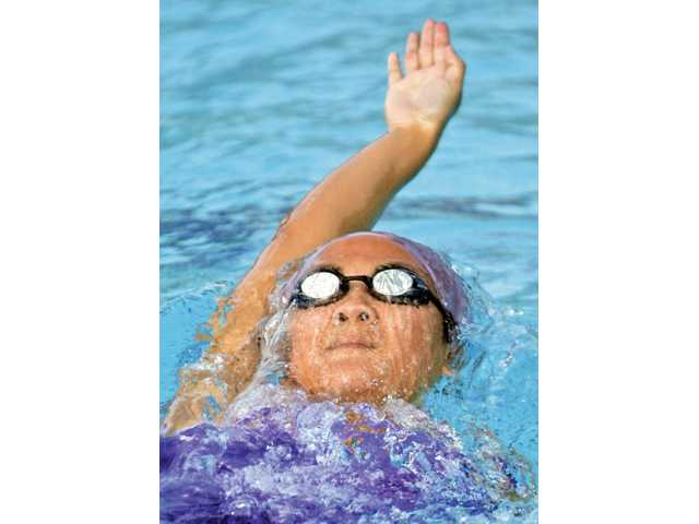 Valencia's Allison Harada swims the backstroke event against West Ranch at the Santa Clarita Aquatic Center on Wednesday. Harada won first place with a time of 1 minute, 4.49 seconds.