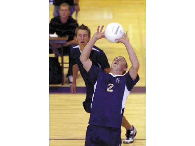 West Ranch's Nate Reynolds sets the ball in the third game of the Wildcats loss to Valencia Thursday night at Valencia High. The Vikings swept the Wildcats in three games.