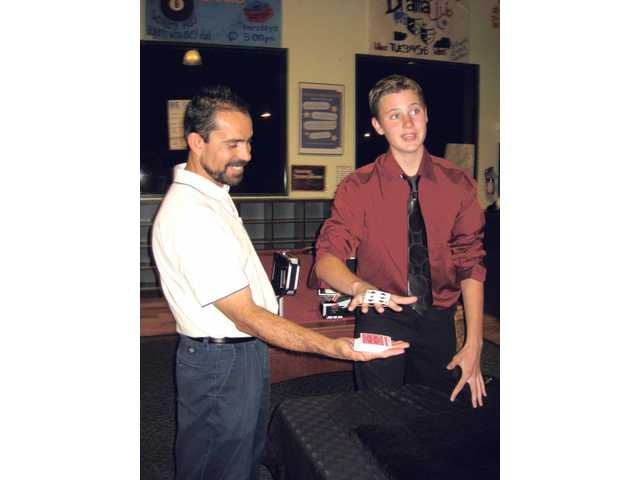 Andrew Grill, right, practices an illusion with fellow magician Everette Gomez for An Evening of Magic, which will be held Saturday in the Boys & Girls Club of the Santa Clarita Valley's gymnasium.