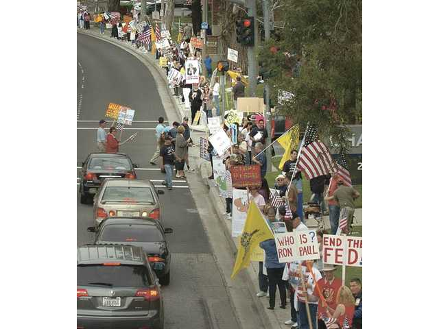 Hundreds line Valencia Boulevard at Citrus Street near Santa Clarita City Hall as they participate in a tea party rally on Thursday evening.