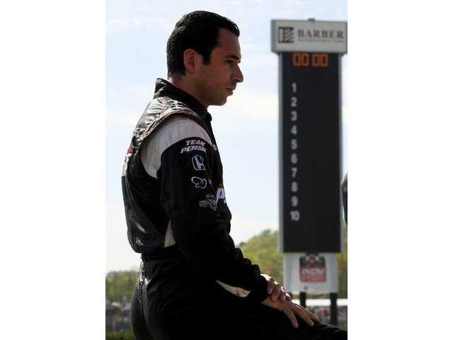 IRL driver Helio Castroneves, of Brazil, looks on during qualifying of the inaugural Indy Grand Prix of Alabama auto race at the Barber Motorsports Park on Saturday, April 10, in Birmingham, Ala.