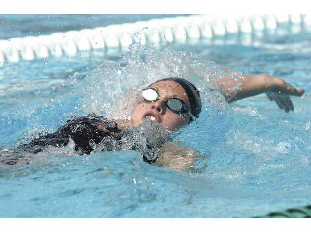 Hart's Maggie Hanson swims the backstroke leg of the girls 200-yard individual medley against Valencia Wednesday at the Santa Clarita Aquatic Center.