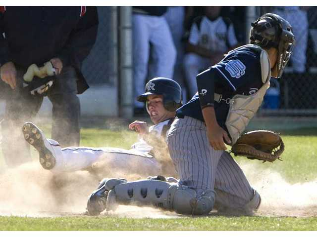 West Ranch's Mitch Thompson, back, slides safely into home as Saugus catcher Dakota Hernandez turns during the sixth inning Wednesday at West Ranch High School. The Wildcats went on to beat the Centurions 9-2.