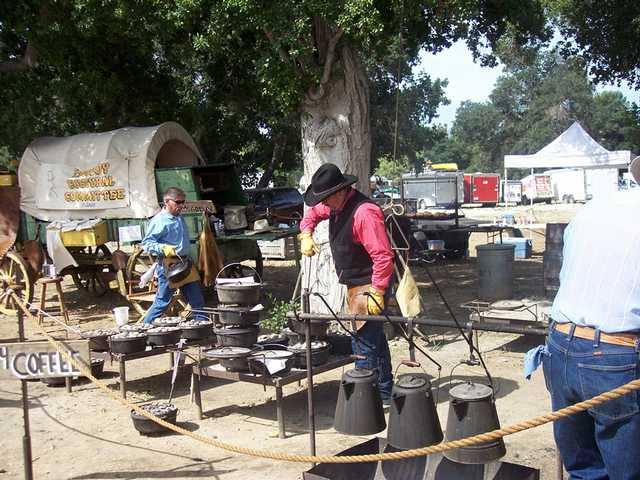 The Cowboy Cultural Committee is a favorite food vendor of Cowboy Festival devotees for their Dutch oven peach cobbler, cowboy coffee and tri-tip sandwiches. A member of the group, which hails from Visalia, tends to the cobbler, which is cooked by coals placed on top of the Dutch ovens.