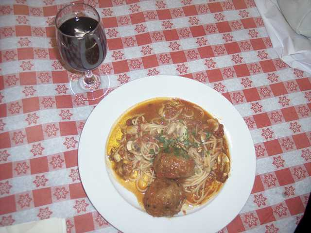 Spaghetti, marinara sauce, meatballs and mushrooms and a glass of wine at pasta night.