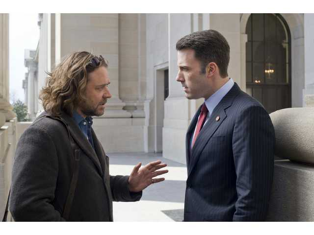 "Russell Crowe, left, and Ben Affleck are shown in a scene from Universal Pictures' ""State of Play."""