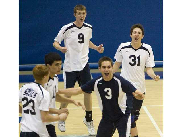 The Saugus High boys volleyball team celebrates its victory Thursday at Saugus High.