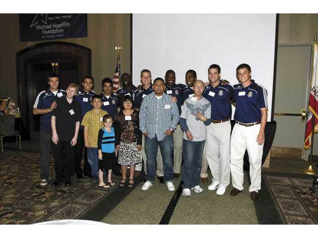 Chivas USA soccer players pose with kids from the Michael Hoefflin Foundation.
