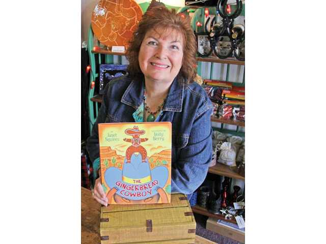 """Janet Squires and her children's book """"The Gingerbread Cowboy"""" which has sold more than 250,000 copies."""