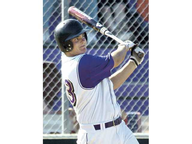 Valencia High's Alex Pitman watches his home run in the fourth inning at Valencia High against Canyon. Pitman hit two home runs in the game.