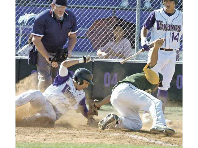Valencia's Alex Bishop, left, slides past the tag of Canyon's Robert Wright Friday at Valencia High. Viking Christian Lopes (14) looks on behind the play.