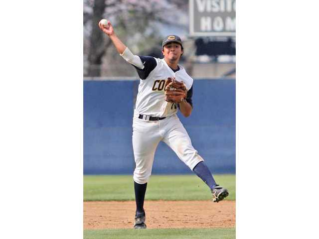 College of the Canyons shortstop Kirk Corrales makes a throw to first base in the ninth inning against West Los Angeles College on Saturday at COC. The Cougars lost 11-6.