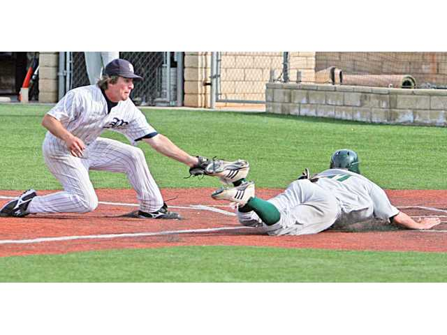 The Master's College pitcher Joe Zeller, left, attempts to tag out Point Loma Nazarene's Wes Kartch at home plate in the sixth inning of the second game on Saturday at Reese Field. The Mustangs lost 11-3 and 7-4 to the Sea Lions, who came into the game as the ninth-ranked team in the NAIA.