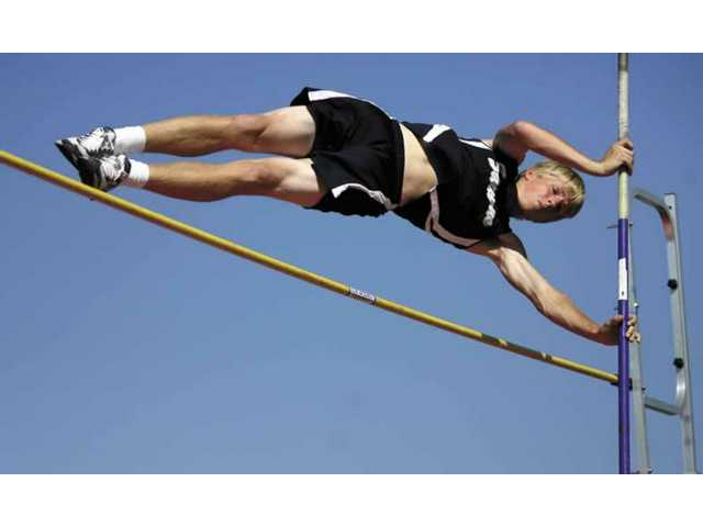 Saugus boys varsity athlete Steven Lowder competes in the pole vault event on Thursday. The Saugus boys team defeated the Grizzlies 72-64 at Golden Valley.