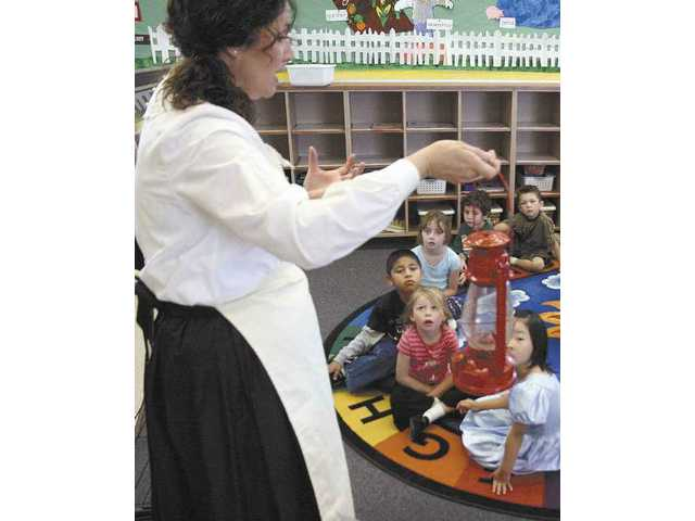 Kathy Harding portrays 19th century lighthouse assistant Abigail Burgess during Keri Jovis' kindergarten class Thursday morjning.