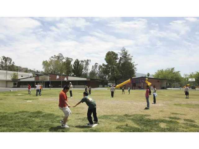 Students from Leona Cox Elementary School play T-ball during an afternoon physical education class last month. The Canyon Country school was named after late resident Leona H. Cox, a former school board member who placed a high value on education.