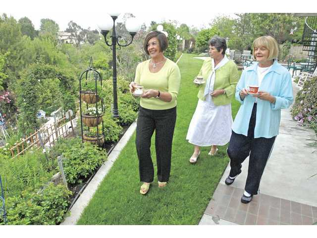 Roberta Zaharris, left, Sally Coss and Gloria Schwindler view Coss' garden at her Valencia home, the site of the ninth annual OLPH Teabags Luncheon and Garden Tour to be held Sunday, April 26.