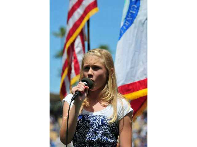 Singer/actress Camille Gray, 12, of Stevenson Ranch, was chosen by Dodgers officials to sing the National Anthem during SCV Dodger Day ceremonies Sunday before the Dodgers' game against the Colorado Rockies.