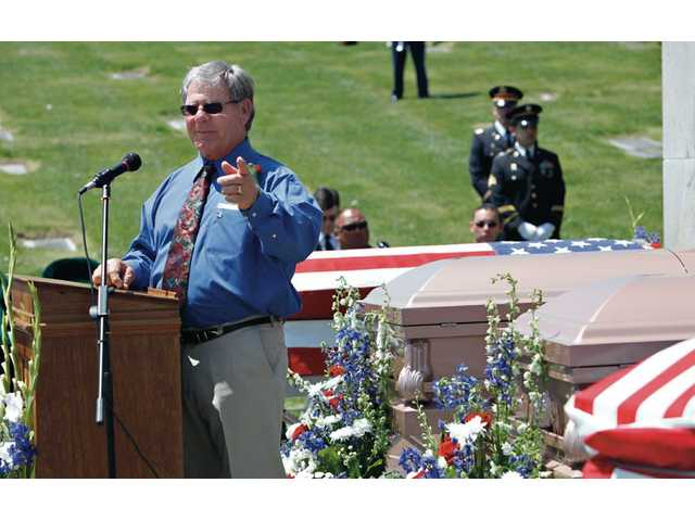 Robert Good, a Bronze Star Recipient in Vietnam War makes a speech during a service for four men who served in the U.S. Armed Forces who were honored in a military ceremony at Eternal Valley Memorial Park.