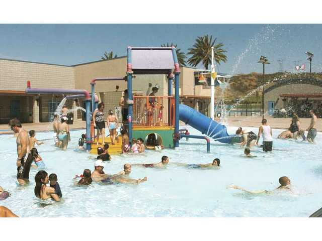 People enjoy the water and summer sun at the Aquatic Center in June 2008. The Santa Clarita Valley offers a variety of programs to keep kids active and mentally stimulated during the summer months.